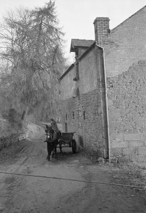 WATER MILL AT WAR: EVERYDAY LIFE AT ERBISTOCK MILL, NEAR RUABON, DENBIGHSHIRE, WALES, UK, 1944