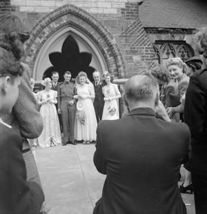 PARISH PRIEST: THE WORK OF THE VICAR OF ST MARK'S CHURCH, VICTORIA DOCKS, SILVERTOWN, LONDON, ENGLAND, UK, 1944