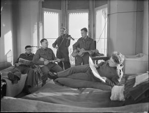 LIBERATED RUSSIAN PRISONERS IN ENGLAND: EVERYDAY LIFE AT THEIR CAMP IN WORTHING, SUSSEX, ENGLAND, UK, 1945