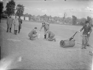 CRICKET MATCH: COVERAGE OF A MATCH BETWEEN KENTON AND ALEXANDRA PARK, KENTON, MIDDLESEX, ENGLAND, UK, 1945