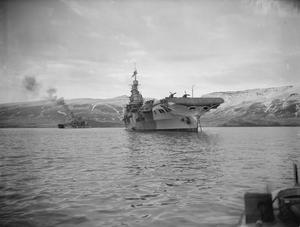 ON BOARD HMS VICTORIOUS. 23 TO 28 JANUARY 1942, ON BOARD THE AIRCRAFT CARRIER AT HVALFJORD, ICELAND. HMS VICTORIOUS ALONG WITH OTHER SHIPS OF THE FLEET ON PATROL IN THE NORTH ATLANTIC IN SEARCH OF THE GERMAN BATTLESHIP TIRPITZ.