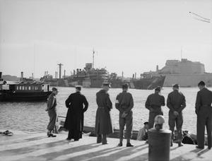 BRITISH REINFORCEMENTS FOR MALTA. 27 JANUARY 1942, GRAND HARBOUR. THE SUPPLY SHIP SS BRECONSHIRE, ESCORTED BY WARSHIPS ARRIVED IN MALTA WITH SUPPLIES AND TROOPS FOR THE ISLAND.