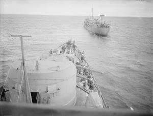 HMS HERMIONE REFUELLING IN THE ATLANTIC FROM THE TANKER RFA DINGLEDALE. 30 JANUARY 1942, ON BOARD HMS HERMIONE.