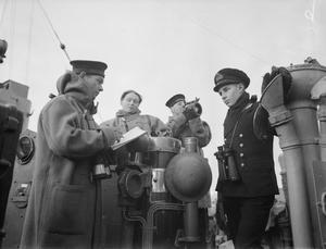 THE LIFE OF A MIDSHIPMAN ON BOARD A DESTROYER. NOVEMBER AND DECEMBER 1941, ON BOARD THE DESTROYER HMS ASHANTI. AFTER LEAVING NAVAL COLLEGE A MIDSHIPMAN IS GENERALLY BORNE IN A BATTLESHIP OR CRUISER, LATER JOINING A DESTROYER FOR THREE MONTHS' EXPERIENCE IN A SMALL SHIP. HIS DUTIES INCLUDE WATCH KEEPING, OFFICER-OF-THE-DAY IN HARBOUR, ANCHOR, CABLE AND BOAT WORK, LEARNING ABOUT GUNS, TORPEDOES AND DEPTH CHARGES, AND TAKING CHARGE OF THE GUN'S CREW AT ACTION STATIONS.