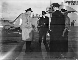 FLEET AIR ARM. 7 JANUARY 1942, ON BOARD HMS VICTORIOUS. FIGHTER PILOTS AND THEIR MACHINES.