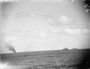 ESCORTING THE SUPPLY SHIP BRECONSHIRE TO MALTA. 18 AND 19 DECEMBER 1941, ON BOARD AN ESCORTING DESTROYER, DURING A CONVOY FROM ALEXANDRIA TO MALTA. DURING THE CONVOY BOTH THE SUPPLY SHIP AND THE ESCORTING WARSHIPS WERE ATTACKED FROM THE AIR BY TORPEDO CARRYING AIRCRAFT AND BOMBERS. GERMAN AND ITALIAN PLANES WERE USED IN THE ATTACK WHICH LASTED OVER FIVE HOURS. NONE OF THE SHIPS OF THE CONVOY WERE DAMAGED AND AN ITALIAN SAVOIA BOMBER WAS SHOT DOWN DURING THE ENGAGEMENT.