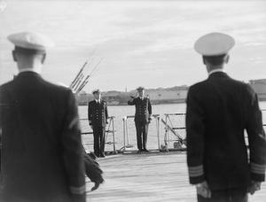 ADMIRAL SIR ANDREW CUNNINGHAM, C IN C MEDITERRANEAN FLEET AT MORNING COLOURS, ON BOARD HMS QUEEN ELIZABETH, NEW YEARS DAY 1942, ALEXANDRIA HARBOUR.