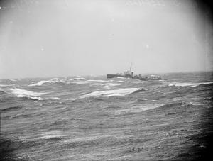 ON BOARD THE AIRCRAFT CARRIER HMS VICTORIOUS SAFEGUARDING THE CONVOY LANES TO RUSSIA. 24 TO 27 MARCH 1942, ON BOARD HMS VICTORIOUS IN WINTRY SEAS.