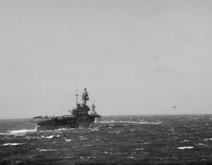 BRITISH AIRCRAFT CARRIERS CONVEY SUPERMARINE SPITFIRES PART WAY TO MALTA. 7 MARCH 1942, ON BOARD THE CRUISER HMS HERMIONE, AT SEA IN THE MEDITERRANEAN. FLYING SUPERMARINE SPITFIRES OFF THE CARRIER HMS EAGLE, THE FIRST TIME SUPERMARINE SPITFIRES HAD BEEN FLOWN OFF.