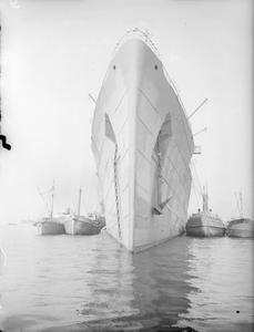 FORMER LUXURY LINER, NOW TROOPSHIP, SS QUEEN MARY AT A BRITISH PORT. 21 MAY 1942, GOUROCK BAY.