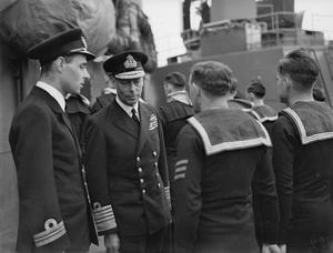 THE KING VISITS HOME FLEET. 7 JUNE 1942, ON BOARD SHIPS OF THE HOME FLEET AND AMERICAN SHIPS SERVING WITH THE FLEET, AT SCAPA.