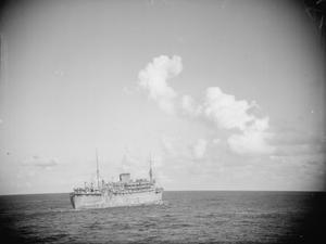 IN CONVOY FROM BOMBAY TO SINGAPORE. FEBRUARY 1942, ON BOARD THE TROOPSHIP DEVONSHIRE DURING PASSAGE FROM BOMBAY TO SINGAPORE AND BATAVIA (DJAKARTA) AND RETURN, IN WHAT WAS PROBABLY THE LAST CONVOY TO REACH SINGAPORE WITH TROOPS AND STORES. APART FROM ONE AIR RAID BY JAPANESE PLANES WHILE PASSING THROUGH THE BANGKA STRAIT, THE JOURNEY WAS UNEVENTFUL.
