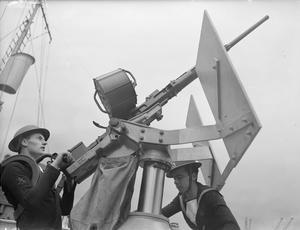 THE OERLIKEN GUN IN ACTION, ON BOARD HMS CELANDINE. 18 JULY 1942.