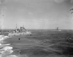 THE BRITISH OPERATIONS AT MADAGASCAR. 7 MAY 1942, ON BOARD THE CRUISER HMS HERMIONE OFF THE COAST OF MADAGASCAR. BRITISH SEA, AIR AND LAND OPERATIONS AT MADAGASCAR WERE SHORT, SHARP AND SUCCESSFUL. FRENCH FORCES SURRENDERED AND A PEACE PROTOCOL WAS SIGNED AT ANTSIRANE WHEREBY THE BRITISH TOOK POSSESSION OF THE NAVAL BASE AT DIEGO SUAREZ.