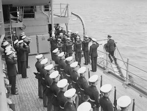 THE KING VISITS THE HOME FLEET AND INSPECTS MEN OF THE US TASK FORCE NOW OPERATING WITH THE BRITISH NAVY.