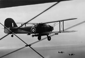 FAIREY ALBACORE AIRCRAFT, FROM HMS FORMIDABLE, TAKING PART IN TORPEDOING EXERCISES OFF MOMBASA. 25 MAY 1942.