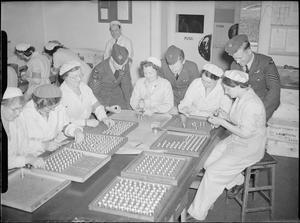 RAF CREWS VISIT A MUNITIONS FACTORY, UK, 1941