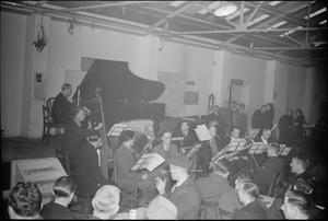 THE FACTORY ORCHESTRA PERFORMS IN THE WORKS CANTEEN, UK, 1942