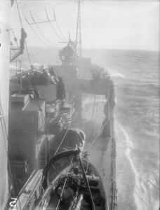 A BRITISH DESTROYER GOES THROUGH HER PACES. 17 FEBRUARY 1943, ON BOARD HMS RAPID, A BRITISH DESTROYER PROVES HER SEA-GOING AND FIGHTING QUALITIES DURING TRIALS AT SEA.