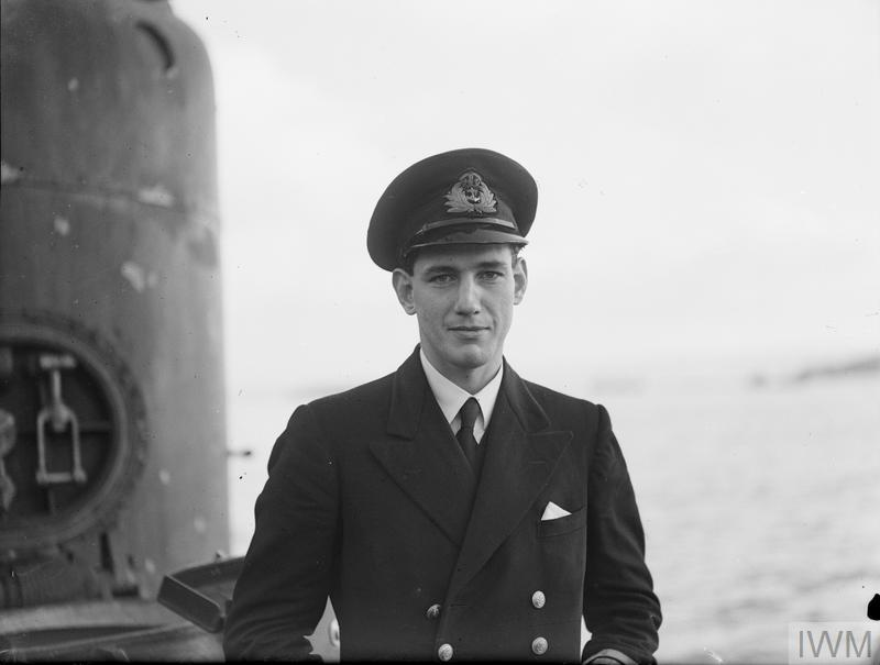 "LT N L A JEWELL, RN - CAPTAIN OF THE ""SECRET MISSION"" SUBMARINE. 25 JANUARY 1943, HOLY LOCH. LT N L A JEWELL, RN, CAPTAIN OF HMS/M 219 HAS MADE SOME SPECTACULAR CONTRIBUTIONS TO THE SUCCESS OF THE ALLIED NORTH AFRICAN OFFENSIVE. ON HIS FIRST OPERATIONAL COMMAND HE WAS ENTRUSTED WITH THREE HIGHLY IMPORTANT SECRET MISSIONS: (1) MAKING IMPORTANT RECONNAISSANCE OFF THE ALGERIAN COAST TO PREPARE FOR THE OFFENSIVE OPENING; (2) LANDING AND RE-EMBARKING THE SECRET MISSION OF US ARMY OFFICERS WHO MADE CONTACT WITH PRE-ALLIED FRENCH LEADERS AND CLEARED THE WAY FOR THE ALLIED OPERATIONS; (3) EMBARKING GENERAL GIRAUD OFF THE FRENCH COAST, TAKING HIM TO THE OPEN MEDITERRANEAN AND TRANSFERRING HIM TO THE FLYING BOAT IN WHICH HE CONTINUED HIS JOURNEY TO GENERAL EISENHOWER'S HQ. LT JEWELL'S SUBMARINE THEN WENT ON TO CARRY OUT A SUCCESSFUL OPERATIONAL PATROL."