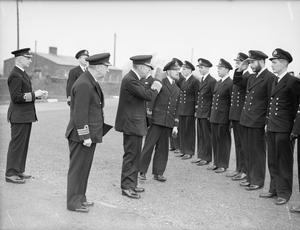 COMMANDER-IN-CHIEF OF EASTERN APPROACHES, MEETS NAVAL OFFICERS AND RATINGS WHO TOOK PART IN THE NORTH AFRICA OPERATIONS. 13 DECEMBER 1942, IN THE PLYMOUTH AREA.