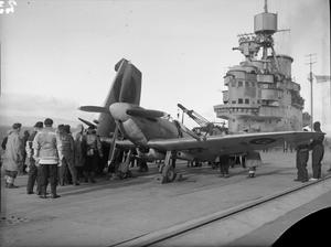 SEAFIRE TRIALS ON HMS ILLUSTRIOUS. 8 AND 9 FEBRUARY 1943, ON THE CLYDE, DURING RECENT TRIALS WITH SEAFIRE AIRCRAFT ON BOARD THE AIRCRAFT CARRIER HMS ILLUSTRIOUS PILOTS WERE VERY IMPRESSED WITH THE EXTREMELY SHORT RUNS NEEDED TO TAKE OFF.