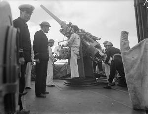ON BOARD THE GREEK CRUISER HHMS GIORGIOS AVEROFF. 23 FEBRUARY 1943, PORT-SAID, REAR ADMIRAL A SAKELLARIOU, COMMANDER IN CHIEF OF THE ROYAL HELLENIC NAVY FLIES HIS FLAG IN THE CRUISER HHMS GIORGIOS AVEROFF.
