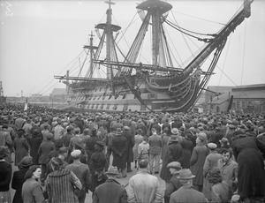 "ARCHBISHOP OF CANTERBURY VISITS HMS ""VICTORY"". 5 MAY 1943, PORTSMOUTH, THE ARCHBISHOP VISITED HMS ""VICTORY"" OF TRAFALGAR FAME. FROM THE CATHEAD OF NELSON HE ADDRESSED OFFICERS, RATINGS, W R N S AND DOCKYARD EMPLOYEES ASSEMBLED IN THE YARD BELOW."