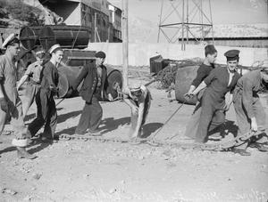 BRITISH SAILORS AND FRENCH DOCKERS WORK TOGETHER NEAR ORAN. 22 AND 23 NOVEMBER 1942, ORAN AND MERS EL KEBIR.