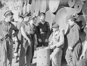 SIGN LANGUAGE HELPS BRITISH SAILORS AND FRENCH DOCKERS TO GET TOGETHER IN NORTH AFRICA. 22 AND 23 NOVEMBER, ORAN AND MERS-EL-KEBIR.