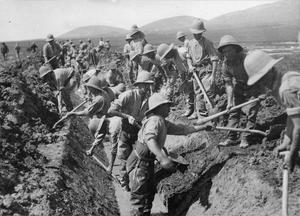 Troops of a British labour battalion digging a drainage channel through the Daubratali Marshes to help destroy the area as a breeding ground of malaria carrying mosquitoes. THE BRITISH ARMY IN THE MACEDONIAN CAMPAIGN, 1915-1918
