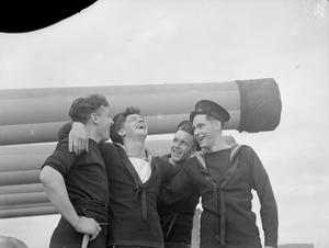 A QUIET SUNDAY ON HMS ANSON. OCTOBER 1942, SCAPA FLOW, MEN OF THE FAMOUS BATTLESHIP SPEND A QUIET SUNDAY IN THE HARBOUR.