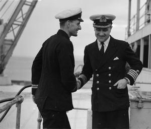 SUBMARINE OFFICER RETURNS TO DEPOT SHIP AFTER SUCCESSFUL PATROL. 6 TO 11 MARCH 1943, ALGIERS.