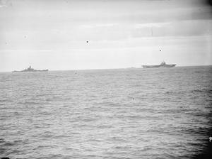 ALLIED NAVAL RECONNAISSANCE IN ENEMY WATERS. 25 TO 29 JULY 1943, ON BOARD HMS GREENVILLE DURING A LARGE SCALE RECONNAISSANCE CARRIED OUT BY BRITISH AND AMERICAN BATTLESHIPS, CRUISERS, AIRCRAFT CARRIERS AND DESTROYERS. FOUR ENEMY AIRCRAFT TRYING TO SHADOW THE GROUP WERE SHOT DOWN.