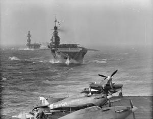 THE BRITISH AIRCRAFT CARRIER INDOMITABLE; FIRST PICTURES. AUGUST 1942, ON MALTA CONVOY, ON BOARD HMS VICTORIOUS. THE NEW AIRCRAFT CARRIER HMS INDOMITABLE, SISTER SHIP OF THE ILLUSTRIOUS AND THE VICTORIOUS, SHE HAS A DISPLACEMENT OF 23,000 TONS, A LENGTH OF 753 FEET AND A COMPLIMENT OF 1600. SHE WAS BUILT BY VICKERS-ARMSTRONG (BARROW), AND BEGUN IN 1937.