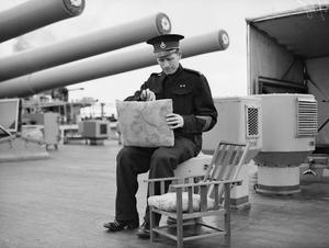 THE NAVY THINKS OF CHRISTMAS. SEPTEMBER 1943, WITH THE HOME FLEET. OFFICERS AND MEN OF HM SHIPS MAKING PRESENTS FOR CHRISTMAS.