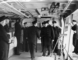 THE PRIME MINISTER AND SIR STAFFORD CRIPPS VISIT THE FLEET. 11 OCTOBER 1942, ON BOARD THE AIRCRAFT CARRIER HMS VICTORIOUS.