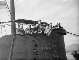 HM SUBMARINE UNA HOME WITH RECORD OF TRIUMPH. 26 MARCH 1943, HOLY LOCH, A TRIPOLI BOUND AXIS SUPPLY SHIP, LADEN WITH SUGAR AND GENERAL CARGO, SUNK BY GUNFIRE; A TORPEDO HIT ON ANOTHER 14,00 TONS ARMED ENEMY SUPPLY SHIP, AND SURFACE ACTIONS AGAINST ITALIAN MOTOR SHIPS AND SHORE BATTERIES ARE AMONG THE SUCCESSES OF HM SUBMARINE UNA WHICH HAS RETURNED TO THE UNITED KINGDOM FOR REFIT AFTER 16 MONTHS IN THE MEDITERRANEAN.