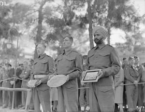 MR CHURCHILL'S 69TH BIRTHDAY IN TEHRAN. 1 DECEMBER 1943, TEHRAN, IRAN. OFFICERS AND MEN OF THE PERSIA AND IRAQ COMMAND WHO FORMED THE GUARD DURING THE PRIME MINISTER'S STAY AT THE BRITISH LEGATION IN TEHRAN, PRESENTED HIM WITH BIRTHDAY GIFTS WHEN HE CELEBRATED HIS 69TH BIRTHDAY THERE. THE REGIMENTS IN THE PAI COMMAND WHICH PRESENTED THE GIFTS WERE THE 4TH HUSSARS, 2ND BATT BUFFS, AND THE 3RD BATT 11TH SIKH REGIMENT (RATTRAY SIKHS).