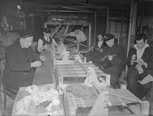 SAILOR CONVALESCENTS MAKE CHRISTMAS PRESENTS. 26 NOVEMBER 1943, KINGSEAT RN AUXILIARY HOSPITAL. SAILOR PATIENTS, NOW CONVALESCING, ARE FILLING THEIR TIME MAKING TOYS AND PRESENTS FOR CHRISTMAS.