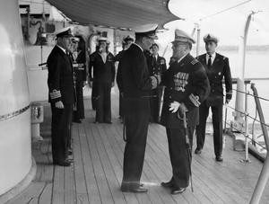 HMS GAMBIA VISITS IRAN. 22 NOVEMBER 1955, ON BOARD HMS GAMBIA, IN IRAN. HMS GAMBIA WEARING THE FLAG OF THE C IN C EAST INDIES, VICE ADMIRAL C F W NORRIS, CB, DSO, VISITING IRAN.