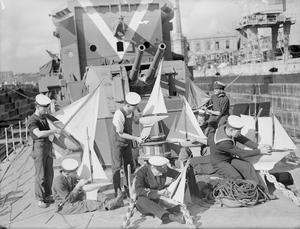 DESTROYER'S MODEL YACHT CLUB. 5 DECEMBER 1943, MALTA. MEN OF THE HUNT CLASS DESTROYER HMS LAUDERDALE HAVE THEIR OWN MODEL YACHT CLUB.