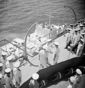 HMS FROBISHER RESCUES A FRENCH DESTROYER. 10 MARCH 1944, COLOMBO, CEYLON. HMS FROBISHER, IMPROVED BIRMINGHAM CLASS CRUISER, BACK FROM THE RESCUE OF THE FRENCH DESTROYER LE TRIOMPHANT. FROBISHER TOWED THE FRENCH DESTROYER 1,200 MILES TO SAFETY.