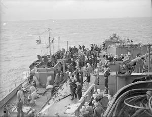 LIBERATION OF EUROPE: CRUISER'S JOB OFF THE NORMANDY COAST. 6 JUNE 1944, ON BOARD HMS FROBISHER, ONE OF THE CRUISERS WHICH DURING THE WEEK BEFORE D-DAY, BOMBARDED ENEMY COASTAL POSITIONS. THE SERIES ALSO COVERS D-DAY ITSELF.