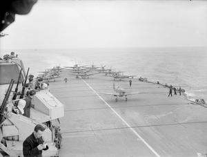 WITH AN AIRCRAFT CARRIER AT SEA. AUGUST 1944, ON BOARD HMS INDEFATIGABLE AT SEA.