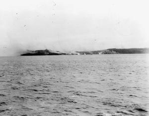 THE BOMBARDMENT OF SABANG. 25 JULY 1944 ON BOARD THE DESTROYER HMS QUILLIAM. BATTLESHIPS, CRUISERS AND DESTROYERS OF THE EASTERN FLEET, SUPPORTED BY CARRIER-BORNE AIRCRAFT, BOMBARDED SABANG, THE JAPANESE HELD NAVAL BASE AT THE ENTRANCE TO THE STRAITS OF MALACCA. THE HARBOUR INSTALLATIONS WERE ALMOST COMPLETELY DESTROYED.