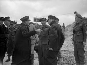 THE KING TOURS THE INVASION BEACHES. 16 JUNE 1944, HM THE KING ACCOMPANIED BY ADMIRAL SIR BERTRAM RAMSAY AND THE FIRST SEA LORD, ADMIRAL SIR ANDREW CUNNINGHAM, TRAVELLED BY THE CRUISER HMS ARETHUSA TO FRANCE, WHERE HE VISITED GENERAL MONTGOMERY'S HEADQUARTERS AND CONFERRED DECORATIONS ON ROYAL NAVY, AND ARMY OFFICERS IN THE FIELD.