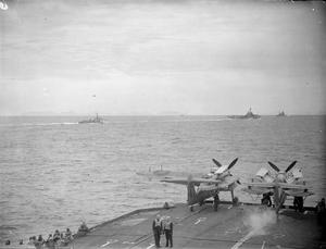 FLEET AIR ARM STRIKES IN NORTHERN WATERS. AUGUST 1944, ON BOARD THE AIRCRAFT CARRIER HMS FORMIDABLE. ON 22, 23, 24, AND 29 AUGUST AIRCRAFT OF THE FLEET AIR ARM SUPPORTED BY UNITS OF THE HOME FLEET CARRIED OUT A SERIES OF RAIDS ON TARGETS IN NORWAY AND PARTICULARLY ON THE GERMAN BATTLESHIP TIRPITZ IN ITS HIDE-OUT IN THE ALTEN FJORD.