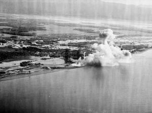 AIR ATTACKS ON JAPANESE BASE AT SIGLI, SUMATRA. 18 SEPTEMBER 1944, FROM ONE OF THE ATTACKING PLANES DURING THE CARRIER-BORNE AIR ATTACK AGAINST THE JAPANESE RAILWAY REPAIR AND MAINTENANCE CENTRE IN SIGLI.