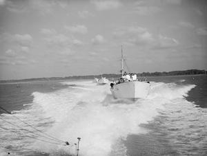 WITH AN MTB FLOTILLA. 6 OCTOBER 1944, FELIXSTOWE. MTBs OF THE 21ST FLOTILLA UNDER THE COMMAND OF LIEUTENANT GEORGE J MACDONALD, DSO, DSC AND 2 BARS, RNZNVR, OF WELLINGTON, NEW ZEALAND. THE CRAFT ARE BUILT BY VOSPER.